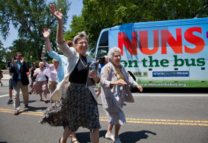 "Sister Simone Campbell, left, and Sister Diane Donoghue, right, lead the way as the the ""Nuns on the Bus"" arrive on Capitol Hill in Washington, Monday, July 2, 2012, after a nine-state tour to bring stories of hardship to Congress. Sister Simone Campbell is executive director of Network, a liberal Catholic social justice lobby in Washington. (AP Photo/J. Scott Applewhite)"